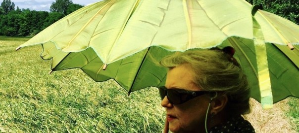 Jennifer Copley-May Artist with green sunshade looking for a subject photo Grace Lee_wm