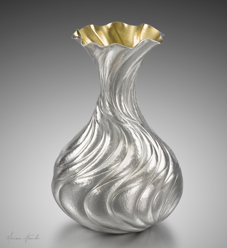 'Cascade Bud Vase' designed to hold just one or two flowers. Hand chased in fine silver, with a lemon gilt interior.