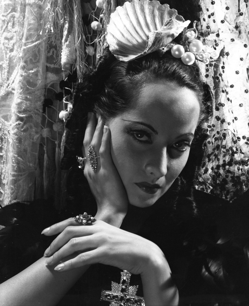 Merle Oberon (1911-1979), Actress, wearing a pearl headdress designed by Cecil Beaton and costume by Oliver Messel, on the set of 'The Private Life of Don Juan', photograph by Cecil Beaton, 1934.  Courtesy of The Cecil Beaton Studio Archive, Sotheby's