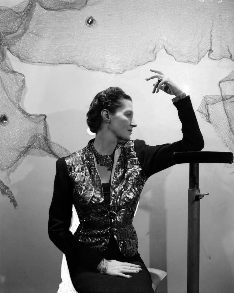 Daisy Fellowes (1890-1962), Paris Editor of American Harper's Bazaar, wearing her commissioned 'Collier Hindou' or 'Tutti Frutti' Cartier necklace and a sequin jacket by Schiaparelli, photograph by Cecil Beaton, 1937.  Courtesy of The Cecil Beaton Studio Archive, Sotheby's
